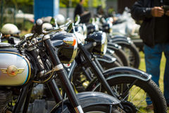 Vintage motorcycles stand in a row Stock Images