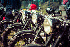 Vintage motorcycles stand in a row Royalty Free Stock Photography
