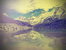 Vintage mountain view of Everest Region with lake, retro style. Stock Photography
