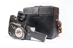 Vintage movie camera and leather case for it isolated on white Stock Images