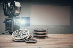 Vintage movie camera with Old style cassettes and film on wooden. Table, mock up royalty free illustration