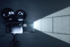 Vintage movie camera with reel of film on grey wall. Close up Stock Photo