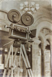 Vintage movie camera on a tripod, model. Processed with retro style. Cinema concept and other antiquities. For Royalty Free Stock Photo