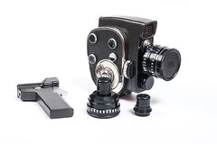 Vintage movie camera and two additional lens isolated on white Royalty Free Stock Photos