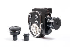Vintage movie camera and two additional lens isolated on white Royalty Free Stock Photo