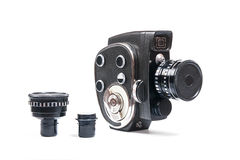 Vintage movie camera and two additional lens  on white Stock Images