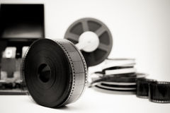 Vintage movie editing desktop in black and white with 35mm reel Stock Photo