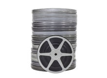 Vintage Movie Film Cans and Reel Isolated. Vintage home movie film cans and reel isolated Royalty Free Stock Photography
