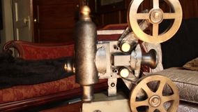 Vintage movie projector Antique Furniture in Background  stock footage