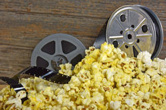 Vintage movie reels with popcorn Royalty Free Stock Photos
