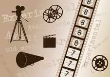 Vintage movies background. Movie camera, film strip, director clapper, megaphone and film roll - vintage Royalty Free Stock Photo