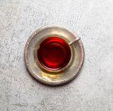 Vintage mug with fragrant tea on a metal saucer on a white background Stock Photography