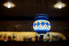 Vintage multi colored ceiling mosaic lamp stock photo