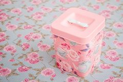 Vintage Multi Purpose Storage Containers with  Floral Pattern. On floral background Royalty Free Stock Images