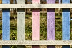 Vintage multicolored wooden fence with gaps. The vintage multicolored wooden fence Stock Photo