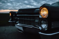 Vintage muscle car on the road Royalty Free Stock Image