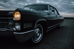 Vintage muscle car on the road Royalty Free Stock Photography