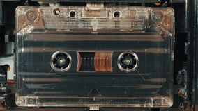 Movement of reels with magnetic tape in an old audio cassette. stock video footage
