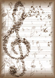 Vintage music notes background. With big clef silhouette Royalty Free Stock Photo