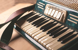 Vintage musical instrument accordion on wooden table. Vintage accordion keys close up photo royalty free stock photography