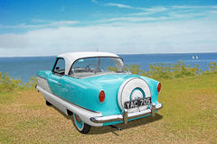 Vintage nash metropolitan car. Photo of a vintage nash metropolitan car once owned by musician phil collins on display at whitstable car show during summer of Royalty Free Stock Images