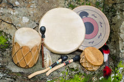 Four Native American Drums with Drumsticks. Royalty Free Stock Images