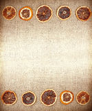 Vintage natural background, dried orange on jute fabric Royalty Free Stock Photo