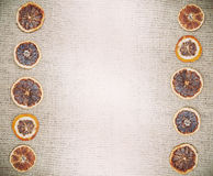 Vintage natural background, dried orange on jute fabric Royalty Free Stock Images