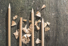 Vintage natural wooden pencils. On dark wooden board Stock Photography