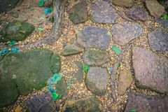 Vintage nature cobblestone and pebbles pavement in disorganized Stock Image