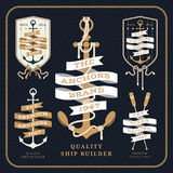 Vintage nautical anchor and ribbon labels set on dark background Royalty Free Stock Image