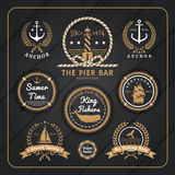 Vintage nautical labels set on dark wood background Stock Images