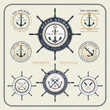 Vintage nautical steering wheel and anchor labels set Royalty Free Stock Photos