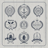 Vintage nautical wreath labels set on light wood background Royalty Free Stock Photography
