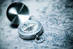 Vintage navigation concept. Vintage compass and old navigation map stock photography