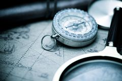 Vintage navigation concept. Vintage compass and old navigation map royalty free stock photos