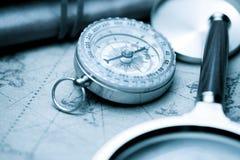Vintage navigation concept. Vintage compass and old navigation map royalty free stock images
