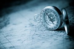 Vintage navigation concept. Vintage compass and old navigation map royalty free stock photography