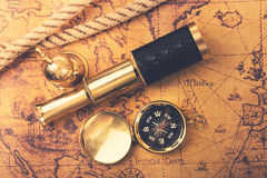 Vintage navigation equipment on old world map. top view Royalty Free Stock Photo