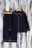 Vintage navy pajama suit. Set of shirt with breast pocket and pants. Classic style boys sleepwear Royalty Free Stock Images