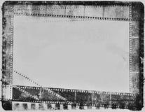 Vintage negativo del blanco del negro de la tira de la película de cine del vintage Imágenes de archivo libres de regalías