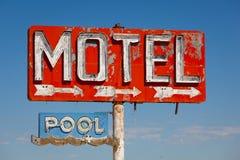 Vintage, neon motel sign. Red, vintage, neon motel sign on blue sky Royalty Free Stock Image