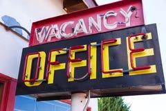Vintage neon vacancy office sign. A retro neon vacancy office hotel sign royalty free stock photos