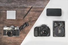 Vintage and new cameras. Technical progress. Vintage and new cameras. Technical progress modern phone Stock Image