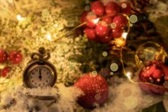 Vintage New year clock and cones covered with snow.  stock photo