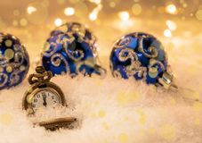 Vintage New year clock and cones covered with snow.  royalty free stock photos
