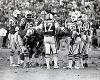 Vintage New York Jets huddle. New York Jets QB Joe Namath, #12 gathers his offense around to call the next play. Image taken from B Stock Image