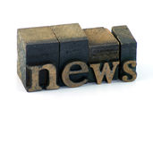 Vintage news. Wooden typescript letters forming the word news Stock Photos
