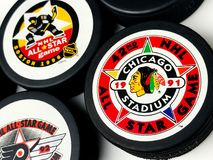 Vintage NHL All-Star Pucks. Vintage look at five NHL hockey pucks with All-Star logos Stock Photography