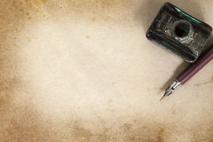 Vintage Nib Pen and Inkwell over Grunge Paper Royalty Free Stock Photo